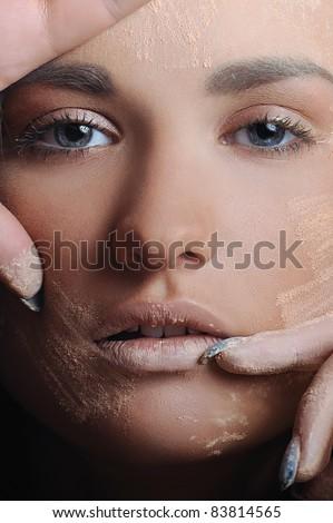 Beautiful women applying female makeup powder - stock photo