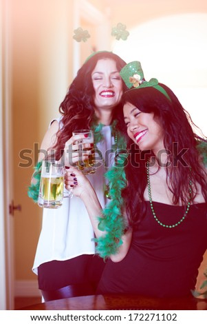 Beautiful women celebrating St Patrick's Day March 17th - stock photo