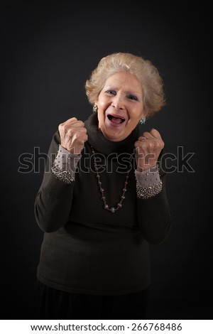 Beautiful women doing different expressions in different sets of clothes: arms raised - stock photo