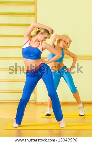 Beautiful women exercising in fitness club - stock photo