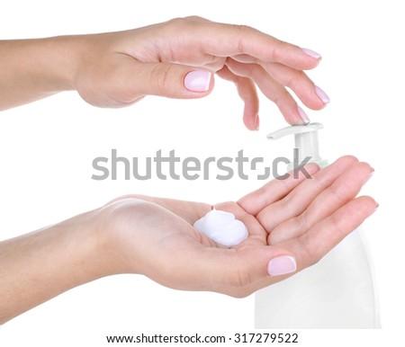 Beautiful women hands applying cream isolated on white - stock photo