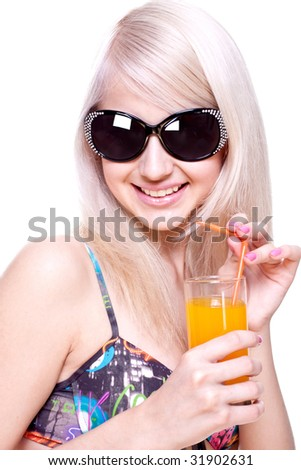 beautiful women in swimsuit with a glass of juice on a white background isolated