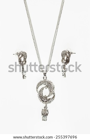 beautiful women jewelry set necklace and earrings on white - stock photo