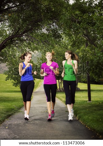 Beautiful Women Jogging Together outdoors