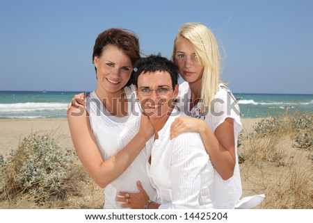 beautiful women on the beach - stock photo