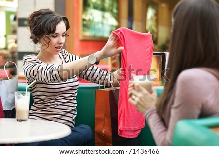 Beautiful women shopping for some clothes at a store - stock photo