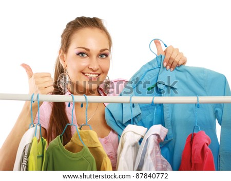 Beautiful women shopping for some clothes at a store isolated on white background