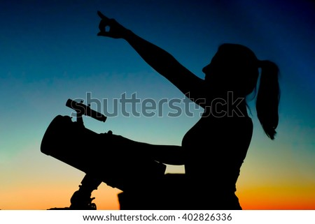 Beautiful Women Silhouette - Beautiful women silhouette with on the setting Sun background.