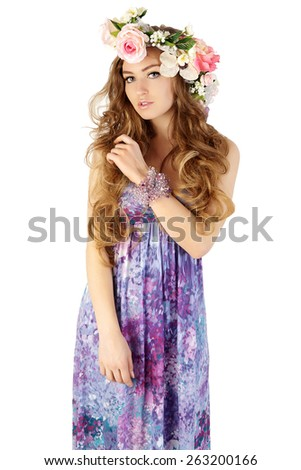 Beautiful women supermodel in wreath of flowers close up portrait. Series of photos made in studio. - stock photo