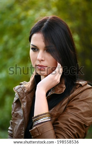 Beautiful women thinking in loneliness in city park - stock photo