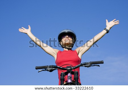 Beautiful women with her arms outstretched isolated on blue sky - stock photo