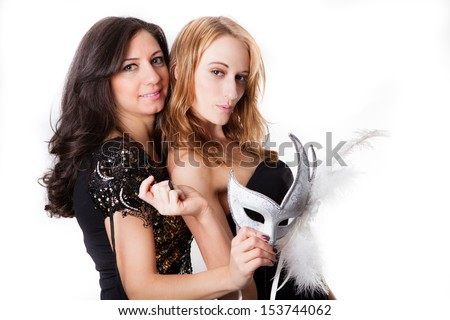 Beautiful Women with Venetian Masks and black dresses Masquerading - stock photo