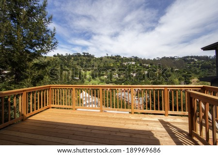 Beautiful wood balcony deck with view - stock photo