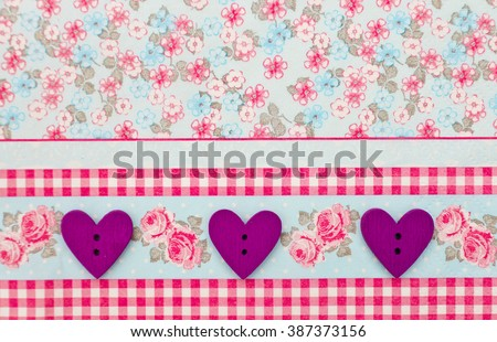 Beautiful wood sewing buttons scrap-booking heart shaped love purple on a delicate floral background, background flowers for postcard, place for text. Figure heart wood handmade,Selective focus - stock photo