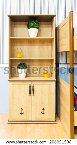 Beautiful wooden cupboard in children's room - stock photo