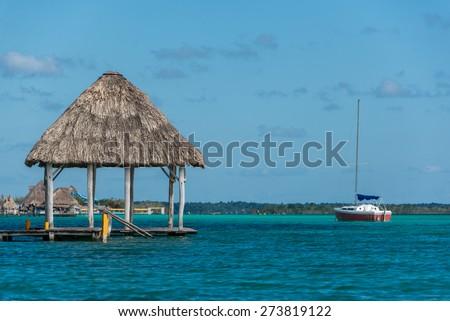 Beautiful wooden Dock at Bacalar Lake traveling riviera maya. Mexico adventure. - stock photo