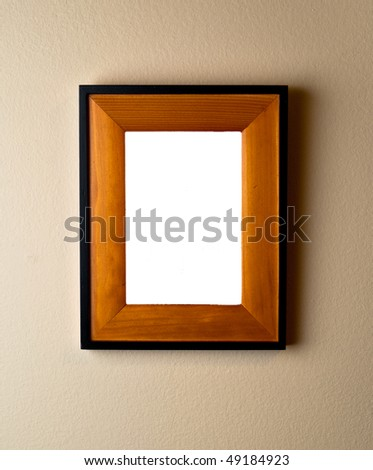 Beautiful wooden frame on wall with blank space. Empty template ready for your custom image or text. - stock photo