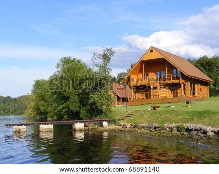 Beautiful wooden house near the river - stock photo