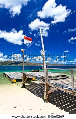 Beautiful wooden pier in tropical island. Gili Nanggu, Indonesia. - stock photo