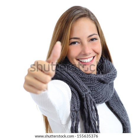 Beautiful wrapped up woman happy in winter isolated on a white background              - stock photo