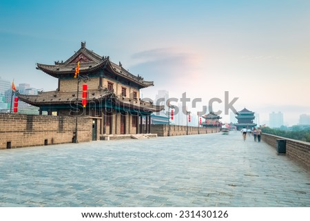 beautiful xian city wall and ancient tower at dusk , China
