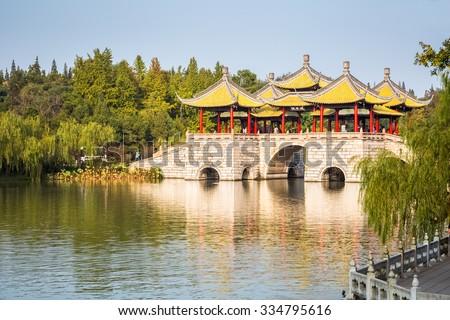 beautiful yangzhou five pavilion bridge closeup on slender west lake ,China - stock photo