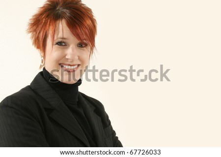 Beautiful 30 year old business woman in black suit with smiling  expression. - stock photo