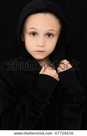Beautiful 7 year old girl in black with worried expression. - stock photo