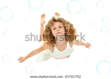 Beautiful 7 year old girl in white dress swimming over white with blue bubbles. - stock photo