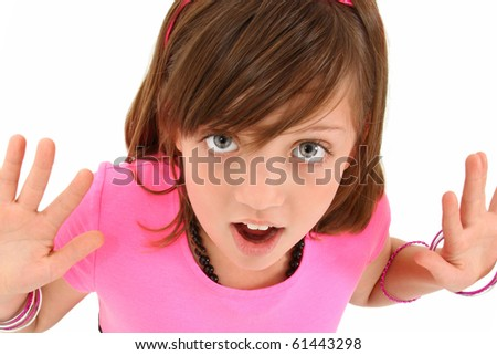 Beautiful 10 year old girl with hands out and surprised expression over white.