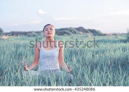 Beautiful Yoga woman In the lotus posture. - stock photo