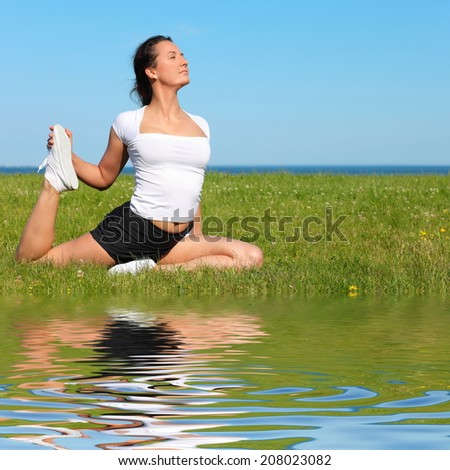 Beautiful Yoga woman Practicing Yoga - stock photo