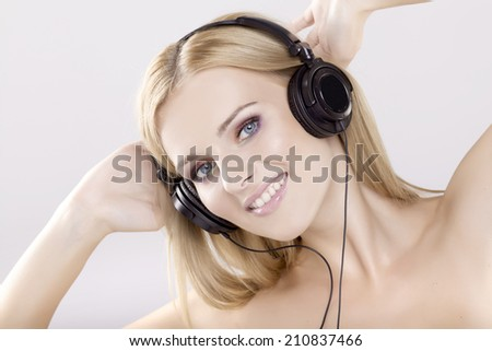Beautiful young adult attractive sensuality blonde girl is listen to the music