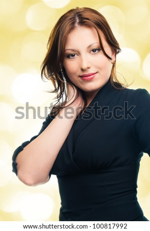Beautiful young adult girl in black elegant dress - stock photo
