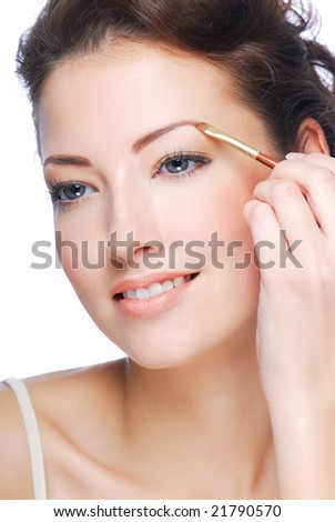 Beautiful young adult woman  draw beauty shape of eyebrows using cosmetic brush Beautiful young adult woman  draw beauty shape of eyebrows using cosmetic brush - stock photo