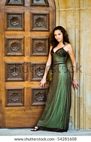 Beautiful young african american girl with brown hair in sparkling green dress