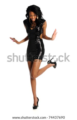 Beautiful young African American woman in black dress isolated over white background - stock photo
