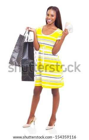 beautiful young african american woman with cash to spend on shopping spree - stock photo