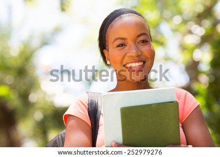 beautiful young african female college student close up - stock photo
