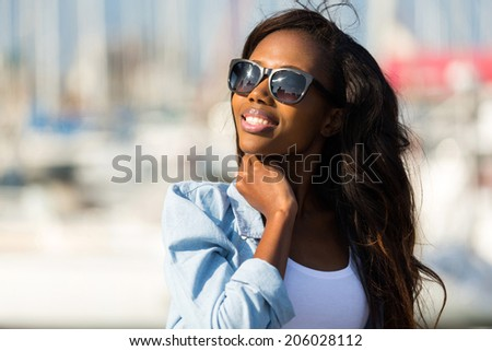 beautiful young african woman wearing sunglasses - stock photo