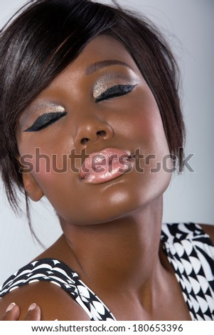 beautiful young african woman with fringe and long hair hairstyle on studio background