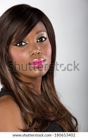 beautiful young african woman with long hair on studio background - stock photo