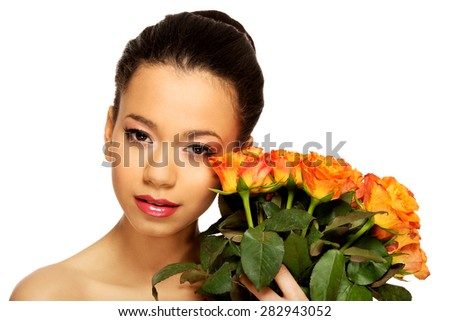 Beautiful young african woman with roses. - stock photo