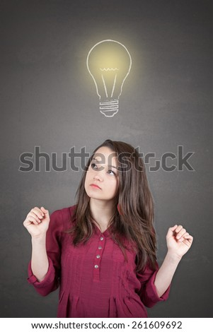 Beautiful young and pretty woman thinking (have no idea) in front of light idea bulb concept
