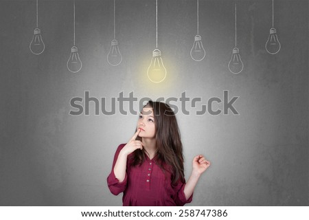 Beautiful young and pretty woman thinking in front of light idea bulbs concept - stock photo