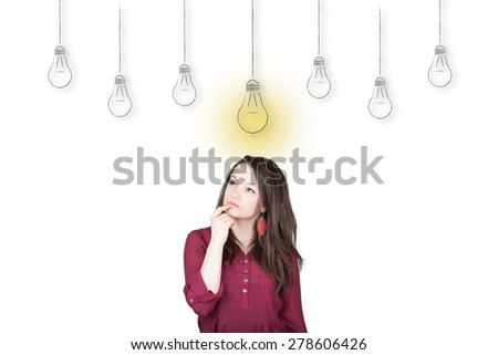 Beautiful young and pretty woman thinking in front of light idea bulbs concept - isolated on white background  - stock photo