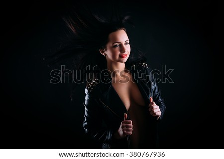 Beautiful young and reckless girl in leather jacket