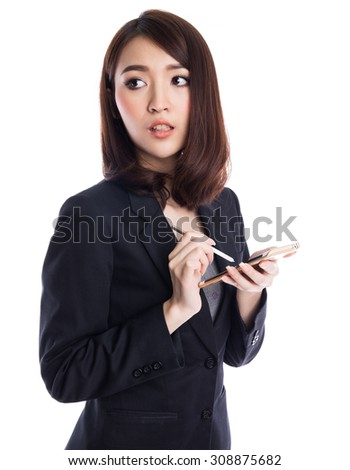 Beautiful young asian business woman typing with stylus on device or smartphone, looking to copyspace,  isolated on white background - stock photo