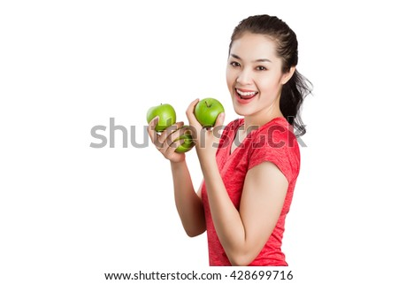 Beautiful young Asian fitness woman happy smile hold green apple. Healthy lifestyle isolated on white background. - stock photo