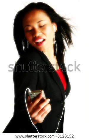 Beautiful young Asian Indonesian woman in business suit listening to digital music player. - stock photo